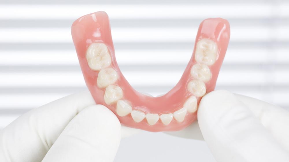 Вставные зубы на присосках
